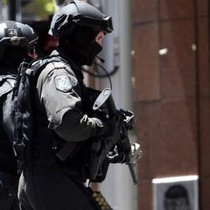 الشرطة الأسترالية تقوم بتطويق مكان احتجاز الرهائن (AFP)