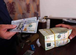 تراجع وتيرة صعود الدولار أمام الدينار الليبي بعد اتفاق فتح النفط